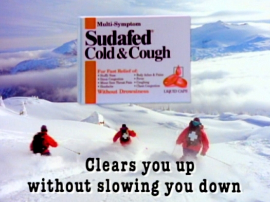 Sudafed TV commercial still showing National Ski Patrol skiing down Mount Mackenzie in British Columbia
